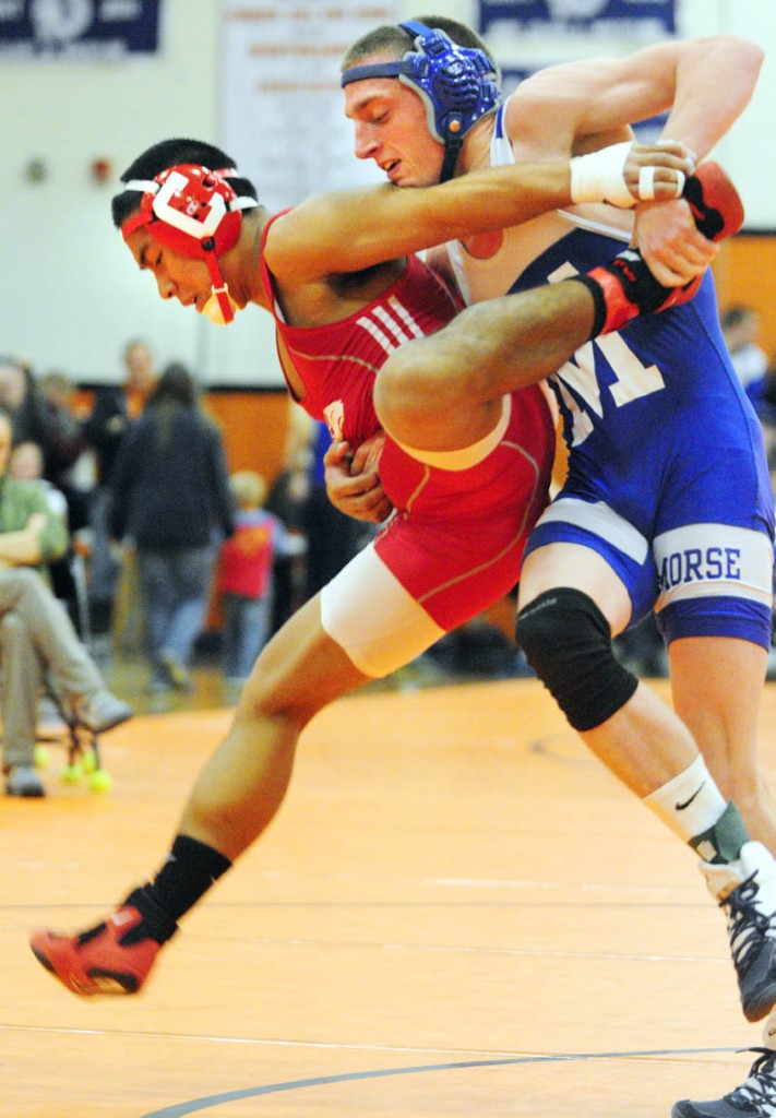 TOUGH BATTLE: Cony's Thon Itthipalakorn, left, and Morse's Wyatt Brackett compete in the 145-pound finals at the Tiger Invitational in the John A. Bragoli Memorial Gym on Saturday at Gardiner Area High School. Brackett won a 2-1 decision.