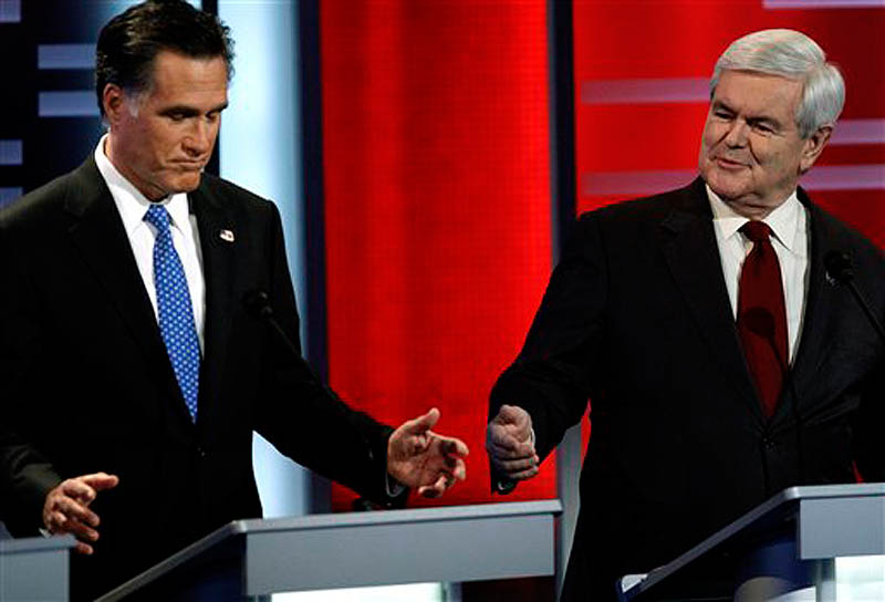 Republican presidential candidates former Massachusetts Gov. Mitt Romney, left, and former Speaker of the House Newt Gingrich, right, during the Republican debate, Saturday, Dec. 10, 2011, in Des Moines, Iowa. (AP Photo/Charlie Neibergall)