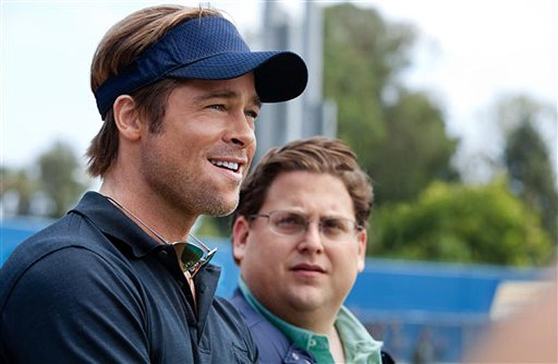 "In this image released by Sony Pictures, Brad Pitt, left, and Jonah Hill are shown in a scene from ""Moneyball."" The film was nominated Thursday, Dec. 15, 2011, for a Golden Globe for best picture drama. Pitt was also nominated for best actor in a drama. The Golden Globes will be presented Jan. 15 at the Beverly Hilton Hotel, televised live by NBC and hosted by Ricky Gervais. (AP Photo/Columbia Pictures-Sony, Melinda Sue Gordon)"