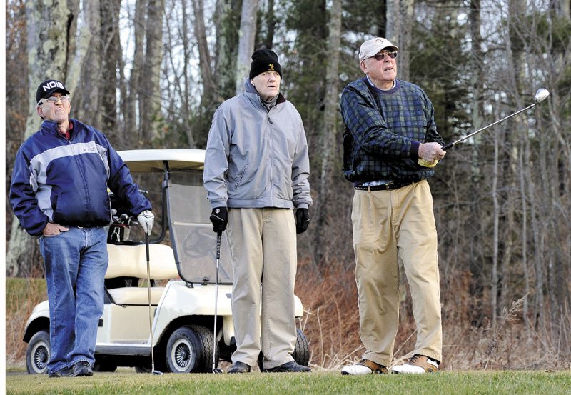 CHIP SHOT: From left, Ron Henderson of South Portland, Larry Bell of Scarborough and Jim Mountain of South Portland enjoy a rare December day golfing Wednesday in 45 degree weather at Nonesuch River Golf Course in Scarborough.