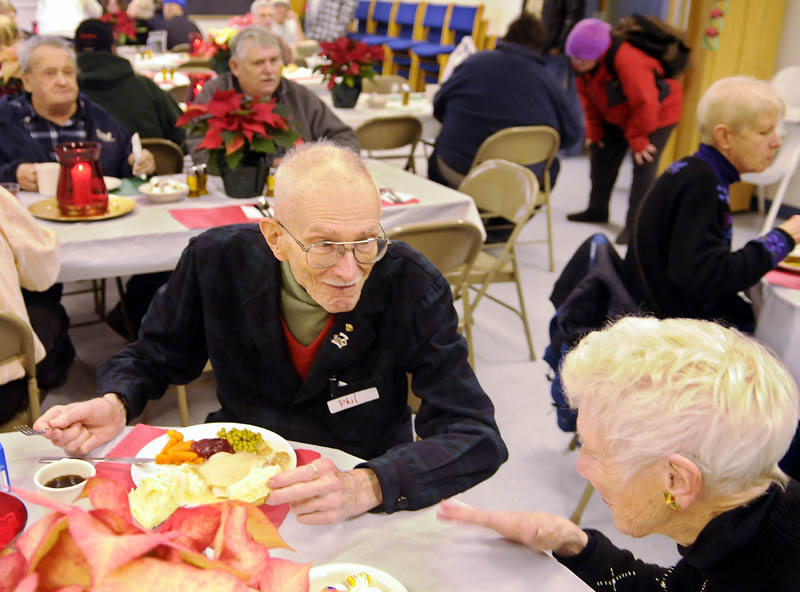 Dorothea Vogel, right, chats with Phil Tiemann Sunday while sharing a table at the community meal served at the Prince of Peace Lutheran Church in Augusta.