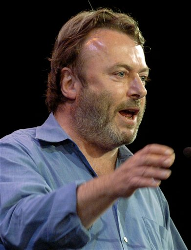 Essayist Christopher Hitchens speaks during a debate on Iraq and the foreign policies of the United States and Britain, in this Sept. 14, 2005 file photo taken in New York. Vanity Fair reports Hitchens died on Thursday Dec. 15, 2011 at the age of 62 from complications of cancer of the esophagus his magazine. The magazine reports he died in the presence of friends at the MD Anderson Cancer Center in Houston, Texas. (AP Photo/Chad Rachman)