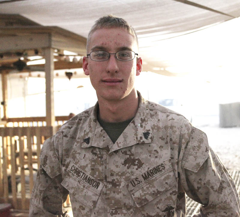 """SERVING OVERSEAS: Cpl. James A. Christianson is a navigation technician with Marine Aviation Logistics Squadron 40. He is deployed to Camp Bastion, Afghanistan, with 2nd Marine Aircraft Wing (Forward). """"It hit me big last year, not being home for Christmas for the first year; and this is the second year,"""" he said. """"I think about home and call at least once a week or more, but you've got to do your job."""""""
