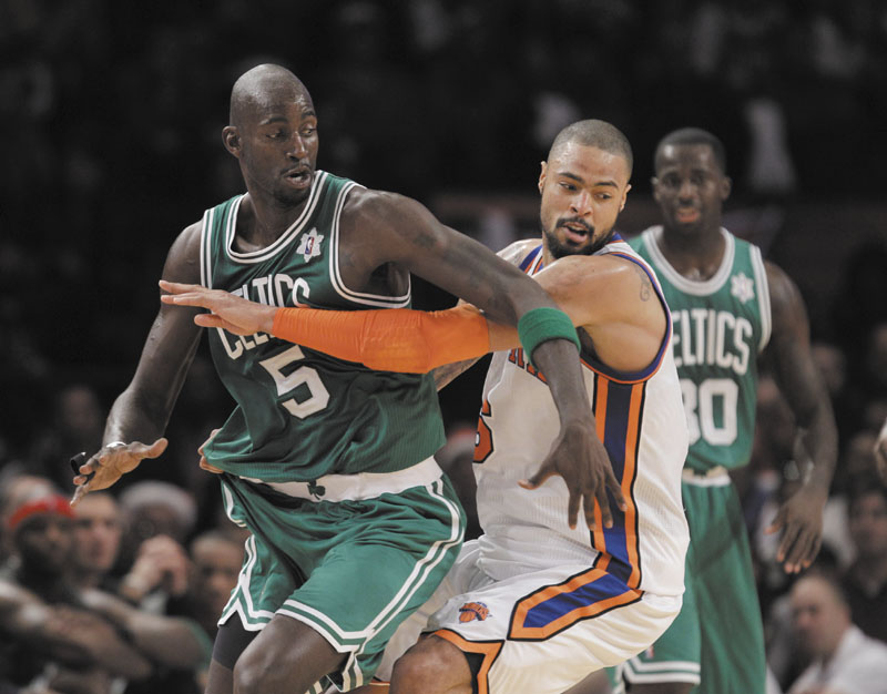 New York Knicks center Tyson Chandler (6) defends against Boston Celtics forward Kevin Garnett (5) in the first half Sunday at Madison Square Garden in New York on Sunday.
