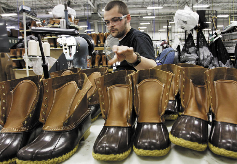 Eric Rego stitches boots in the facility where L.L. Bean boots are assembled in Brunswick.