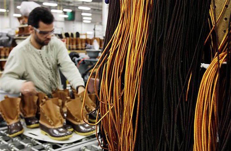 Amer Saleh of Westbrook puts laces on L.L. Bean boots in the Brunswick facility where they are assembled on Dec. 14. The popularity of L.L. Bean's famed hunting boots has prompted the Freeport-based retailer to hire as many as 125 full-time manufacturing employees.