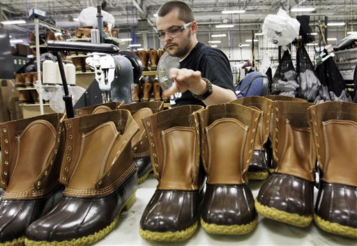 Eric Rego of East Boothbay stitches boots in the Brunswick facility.