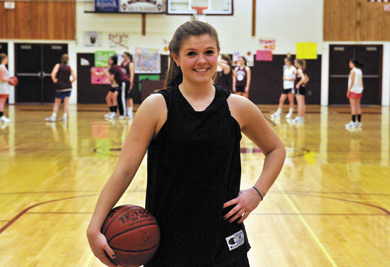 READY TO PLAY: Nokomis High School basketball player Megan Perry poses for a portrait before practice Wednesday in Newport.
