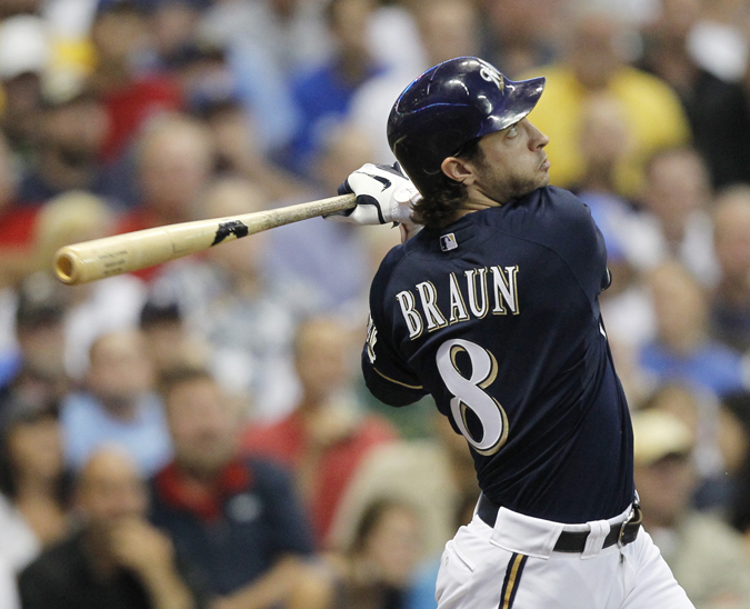 Milwaukee Brewers' Ryan Braun follows through for a home run during a game against the Los Angeles Dodgers in this Aug. 15, 2011, photo.