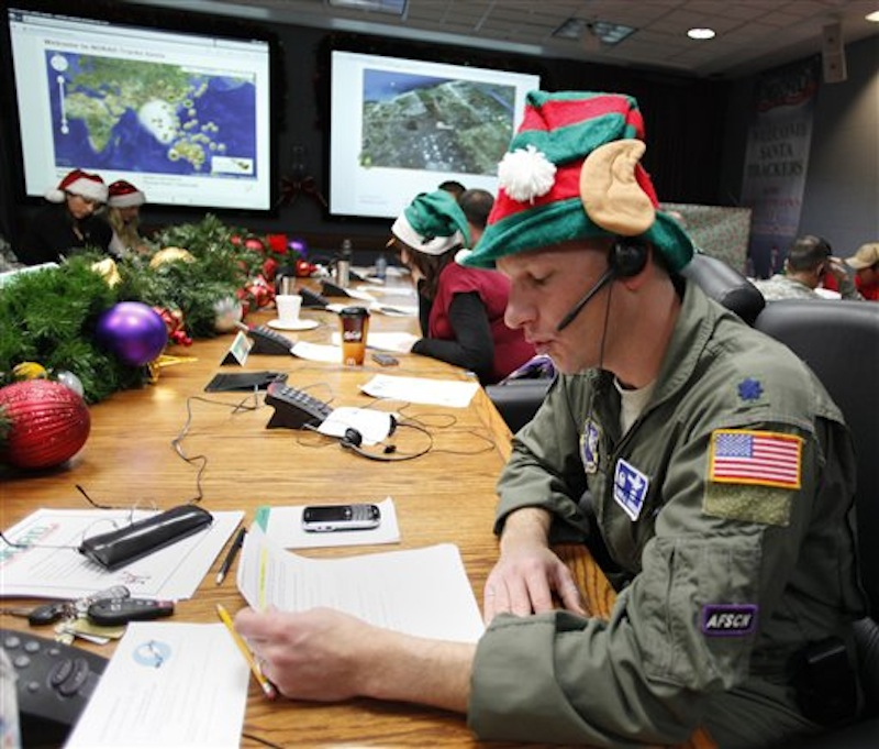 In this Dec. 24, 2010 file photo, Air Force Lt. Col. David Hanson, of Chicago, takes a phone call from a child in Florida at the Santa Tracking Operations Center at Peterson Air Force Base near Colorado Springs, Colo. (AP Photo/Ed Andrieski)