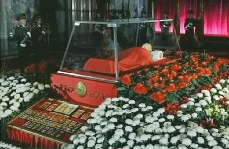 In this image made from KRT television, the body of North Korean leader Kim Jong Il lies in a memorial palace in Pyongyang today.