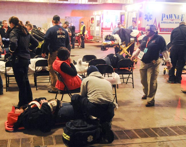 Emergency medical personnel tend to injured fans under Boone Pickens Stadium following Oklahoma State's 44-10 win over rival Oklahoma in an NCAA college football game in Stillwater, Okla., on Saturday.