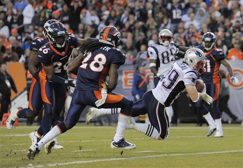 New England Patriots running back Danny Woodhead (39) crosses the goal line for a touchdown as Denver Broncos free safety Quinton Carter (28) and free safety Rahim Moore (26) defend in the third quarter of an NFL football game, Sunday, Dec. 18, 2011, in Denver. (AP Photo/Jack Dempsey) NFLACTION11;