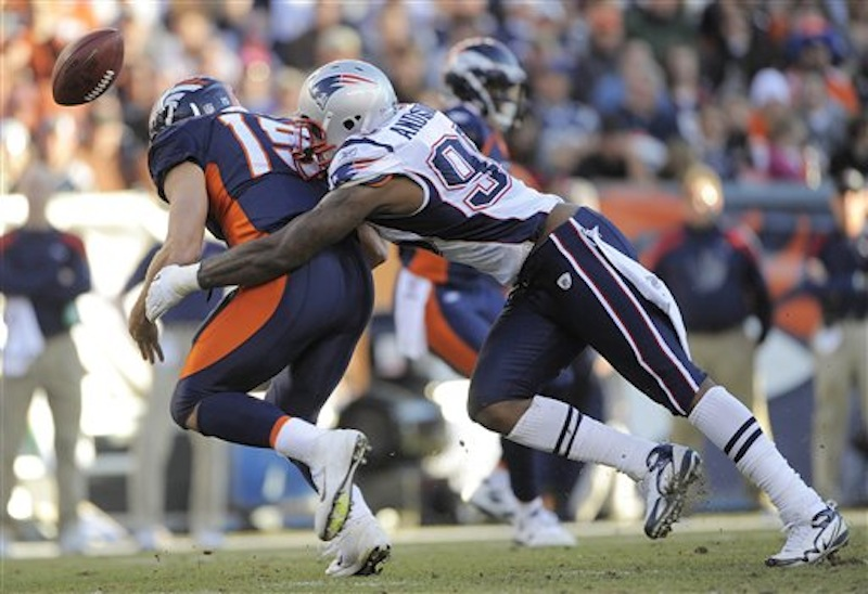 Denver Broncos quarterback Tim Tebow (15) fumbles the ball as he is hit by New England Patriots defensive end Mark Anderson (95) in the second quarter of an NFL football game, Sunday, Dec. 18, 2011, in Denver. (AP Photo/Jack Dempsey) NFLACTION11;