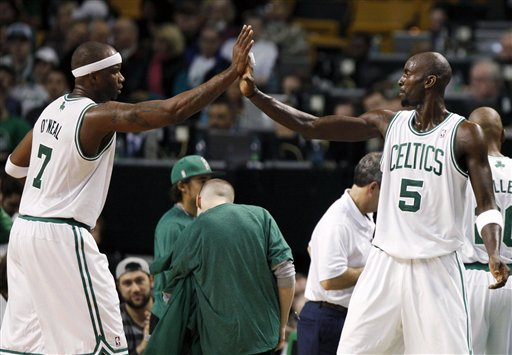 Boston Celtics' Jermaine O'Neal (7) gives a high-five to teammate Kevin Garnett as he comes off the court in the second half of the Celtics 96-85 win over the Detroit Pistons on Friday in Boston.