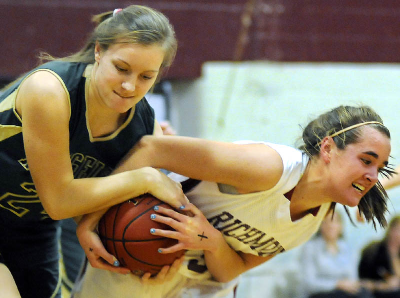 IT'S MINE: Richmond High School's Jamie Plummer, right, pulls the ball away from Rangeley Lakes Regional High School's Jenney Abbott during a game Tuesday in Richmond.