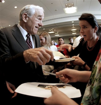 Republican presidential candidate, Rep. Ron Paul, R-Texas signs autographs during a campaign stop in Dubuque, Iowa, Thursday, Dec. 22, 2011. (AP Photo/Charlie Riedel)