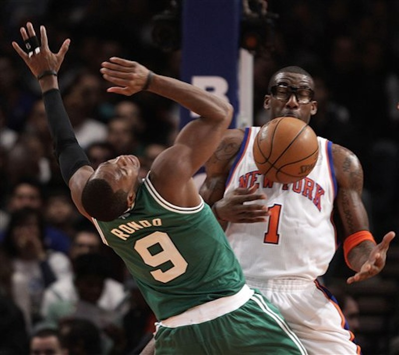 New York Knicks forward Amare Stoudemire (1) defends as Boston Celtics point guard Rajon Rondo (9) loses control of the ball in the second quarter of their NBA basketball game at Madison Square Garden in New York, Sunday, Dec. 25, 2011. (AP Photo/Kathy Willens) Amare Stoudemire, Rajon Rondo