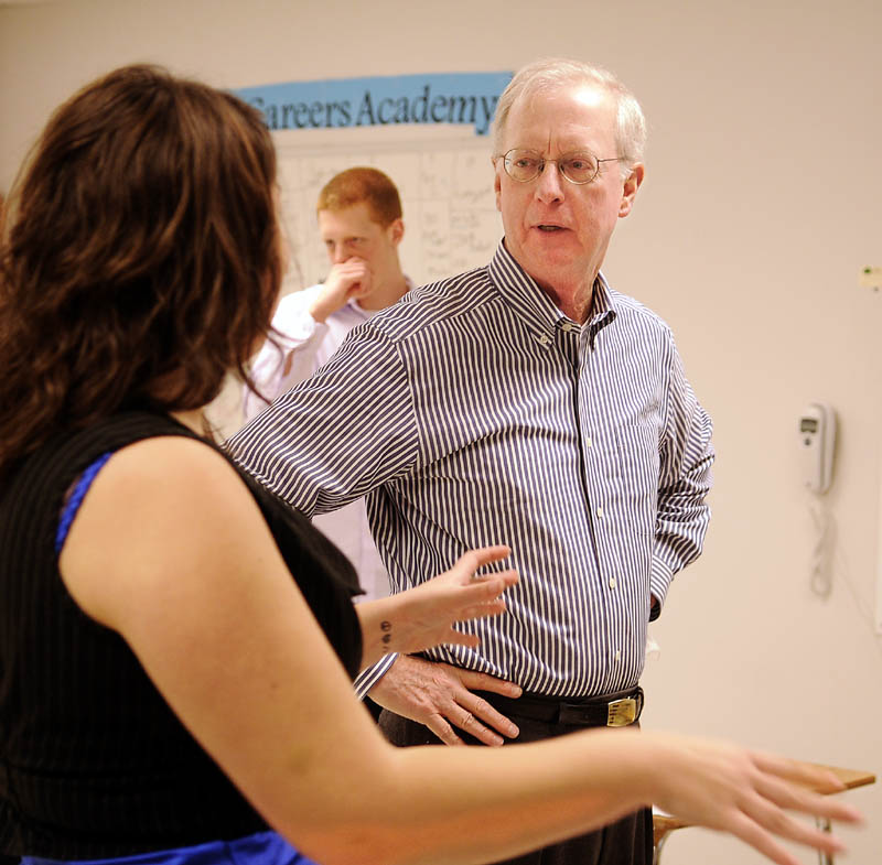 HELPING HAND: Ed Ross, from the national nonprofit organization SCORE, speaks with Capital Area Technical Center student Mariah Hazard, left, Tuesday at the Augusta school.