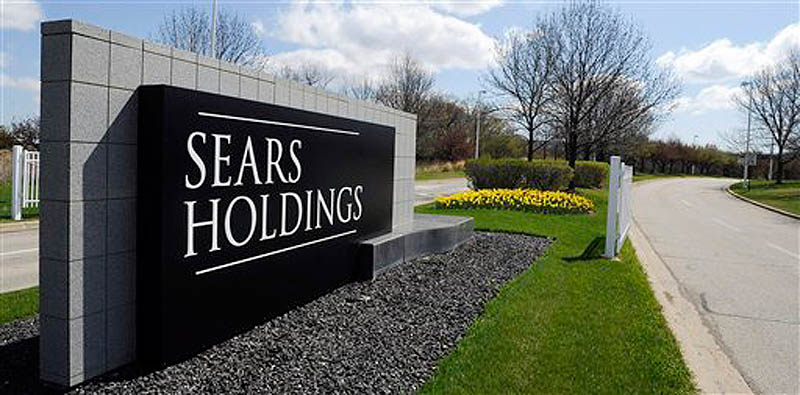 This May 4, 2011 file photo shows the entrance to the Sears Holdings Corp. in Hoffman Estates, Ill. (AP Photo/Daily Herald, Mark Welsh, File)