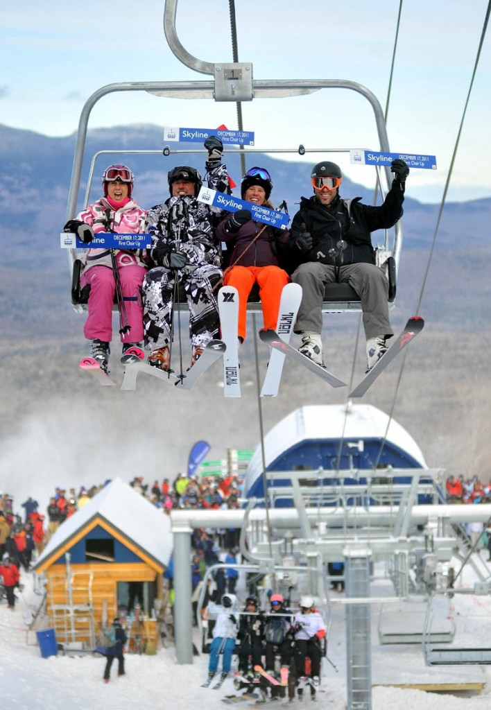 HERE WE GO: From left to right, Meredith Strang Burgess, Doug Stewart, Chris Proulx and Chad Coleman are the first skiers to ride the new Skyline lift at Sugarloaf Mountain on Saturday morning. Saturday was the first day of operations for the rebuilt lift that was closed after last season's lift accident.
