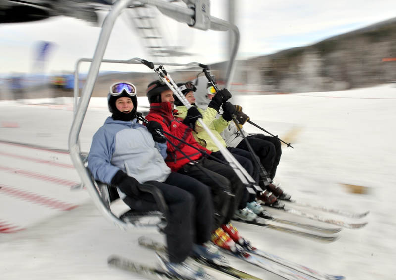 Staff photo by Michael G. Seamans Skiers load on to the Skyline lift at Sugarloaf Saturday morning.