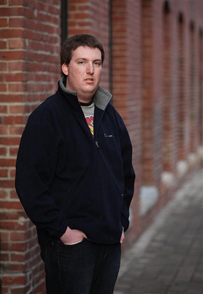 Zach Tomaselli, 23, poses Monday, Nov. 28, 2011 in Lewiston, Maine. Tomaselli is the third man to accuse former Syracuse assistant head coach Bernie Fine of sexual abuse. (AP Photo/Joel Page)