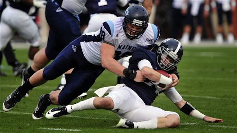 Georgia Southern quarterback Jaybo Shaw (14) is tackled by Maine defensive lineman Craig Capella (98) during the first half of an NCAA college football game, Saturday, Dec. 10, 2011 in Statesboro, Ga. (AP Photo/Stephen Morton)
