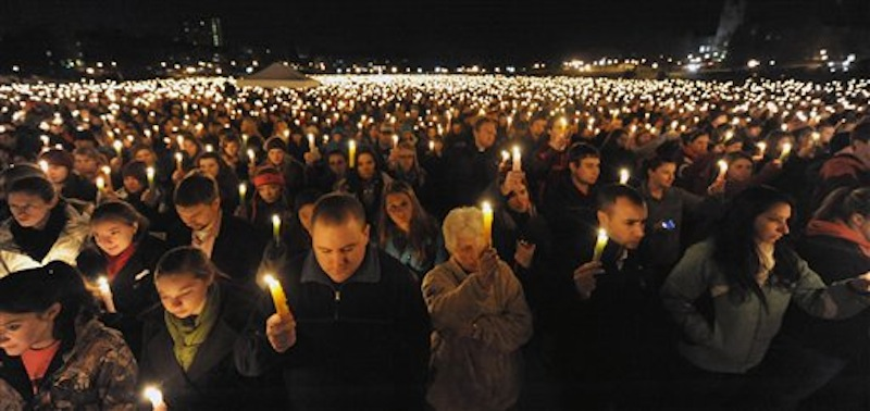 Virginia Tech students hold a candlelight vigil on the drill field, on campus, as a memorial to Virginia Tech police Officer Deriek Crouse who was gunned down Thursday during a traffic stop on the campus of Virginia Tech in Blacksburg, Va., Friday, Dec. 9, 2011. (AP Photo/Don Petersen)