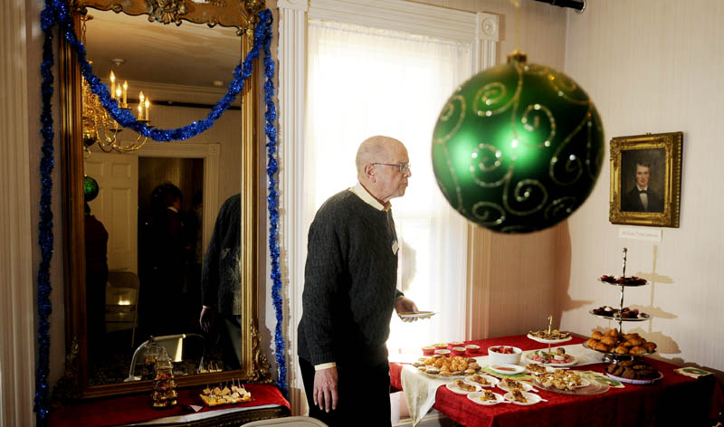 Bruce Kirkham samples a sweet Sunday during the Victorian tea at the Kennebec Historical Society in Augusta.