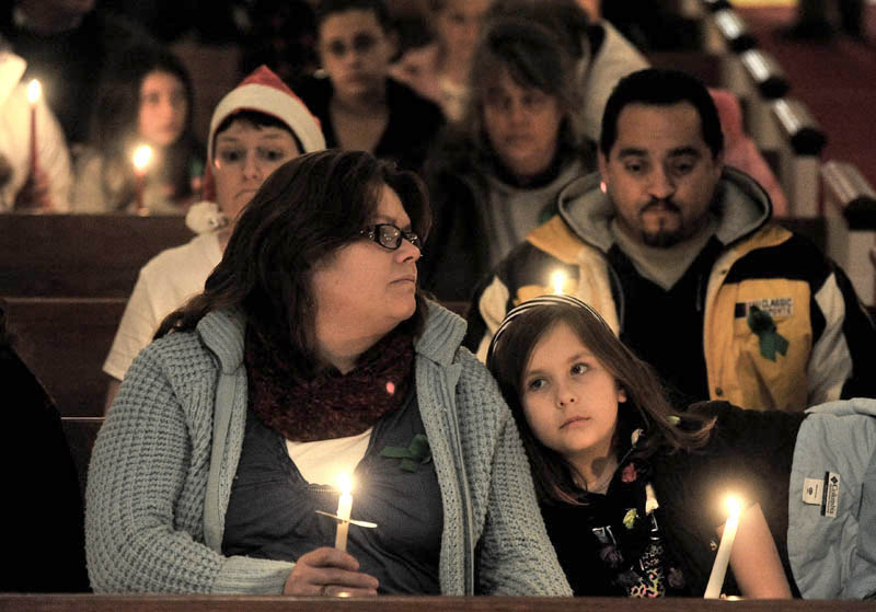 Katherine McIntyre, left, sits with her daughter Noelle, 7, during the Vigil Of Hope For Ayla Reynolds organized by The Mainely Moms & Dads Wednesday evening in the First Congregational Church.