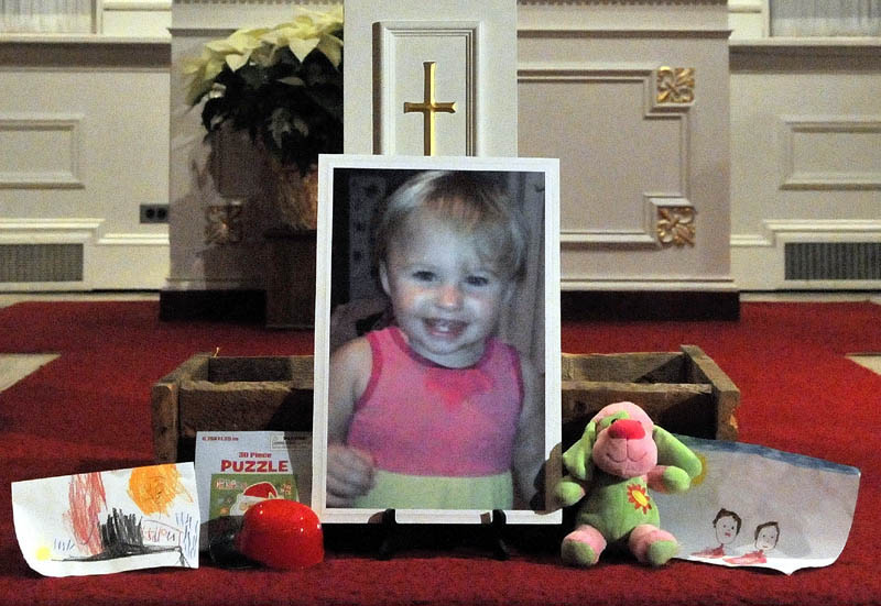 A photo of missing 20-month-old Ayla Reynolds sits on the altar at the First Congregational Church in Waterville during the Vigil Of Hope For Ayla Reynolds Wednesday night.