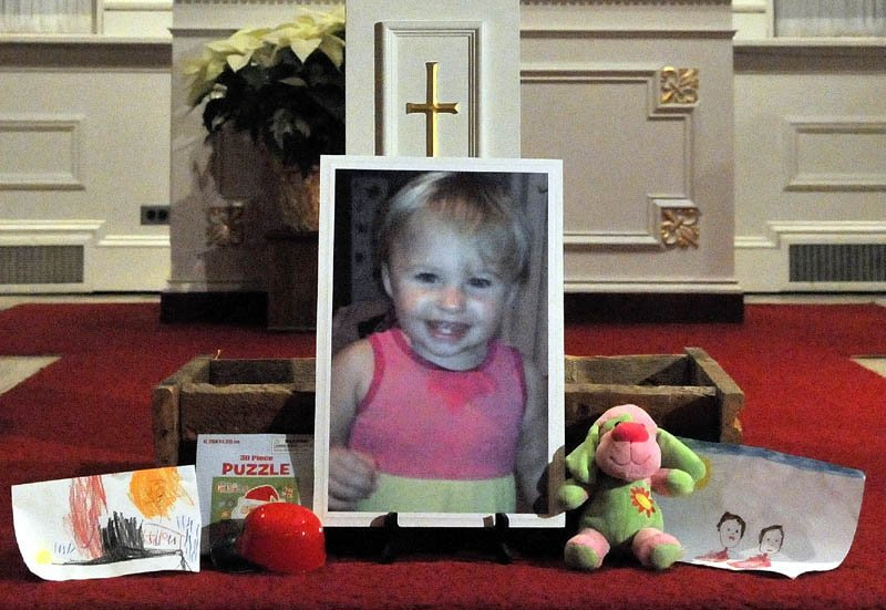"""A photo of missing 20-month-old Ayla Reynolds sits on the altar at the First Congregational Church in Waterville during the """"Vigil Of Hope For Ayla Reynolds"""" Wednesday night."""