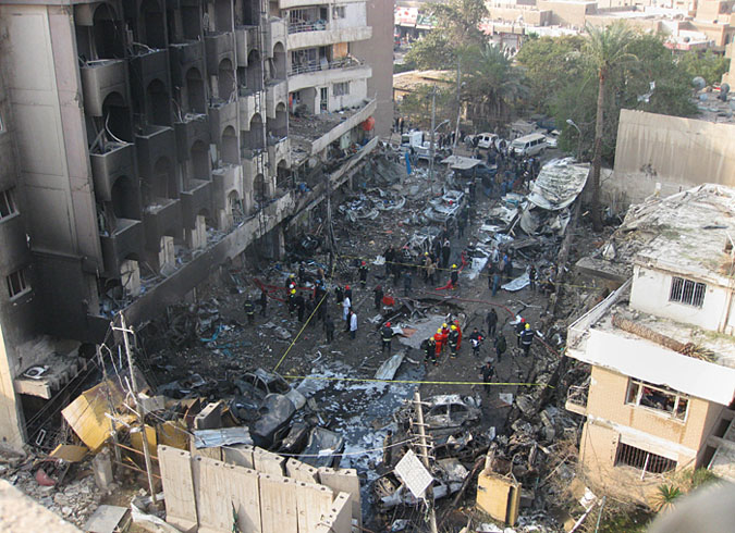 Iraqi security forces gather the scene of a car bomb attack in Baghdad Thursday. A wave of bombings ripped across Baghdad in the worst violence Iraq has seen for months. The bloodbath comes just days after American forces left the country.