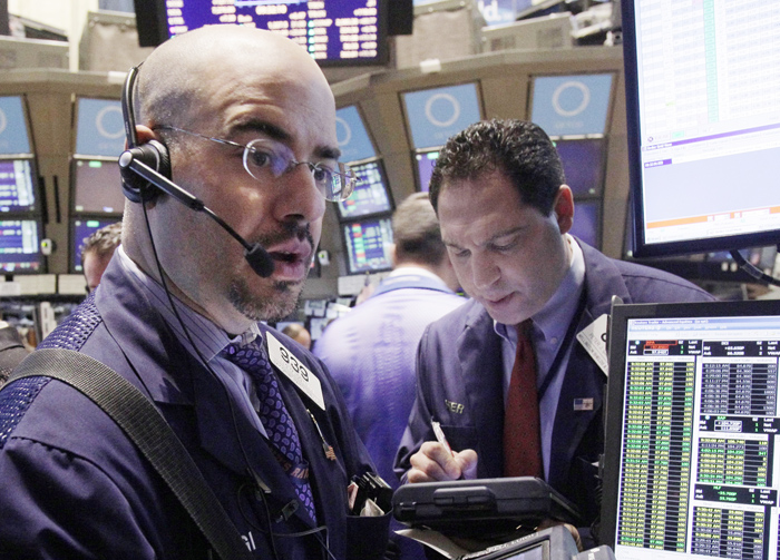 Traders work on the floor of the New York Stock Exchange. This week's strong stock performance is partially a reflection of the market's increased volatility since August, when concerns that Europe's debt was spinning out of control made dramatic stock price swings the norm.