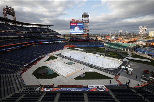 Crews work on the ice rink in preparation for NHL's Winter Classic at Citizens Bank Park on Wednesday in Philadelphia. The New York Rangers and the Philadelphia Flyers are scheduled to play on Monday.