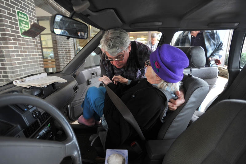 Staff photo by Michael G. Seamans Larry Barkow lifts his mother-in-law, Alice, into the car as they leave Franklin Memorial Hospital in Farmington after a routine bi-weekly check-up on November 15, 2011.