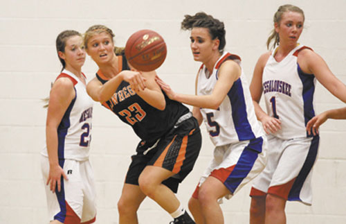 TIME TO PASS IT ON: Skowhegan Area High School's Adriana Martineau looks to pass the ball to Natasha Thompson (not shown) while being defended by Messalonskee High School's Rachael Wacome during first-half action in Oakland on Friday night.