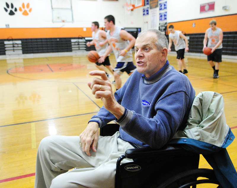 IN THE GAME: Art Warren answers questions during a interview held during Gardiner Area High School boys basketball practice recently in the John A. Bragoli Memorial Gym in Gardiner. Warren, a long-time coach and educator in Gardiner, was diagnosed with ALS a year ago.
