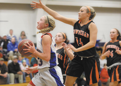 JUST OUT OF REACH: Messalonskee High School's Mikayla Turner, left, puts up a shot just out of reach of Skowhegan Area High School's Amanda Johnson during first-half action Friday night in Oakland.
