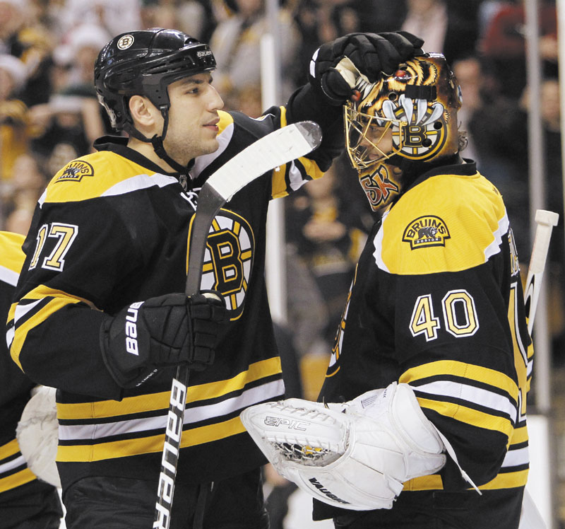 ON A ROLL: After a slow start to their season, the Boston Bruins have won 20 of their last 23 games. Milan Lucic, left is part of an offense that has scored an NHL-best 119 goals, while goalie Tuukka Rask, right, is part of one of the top goaltending tandems in the league, along with Tim Thomas.