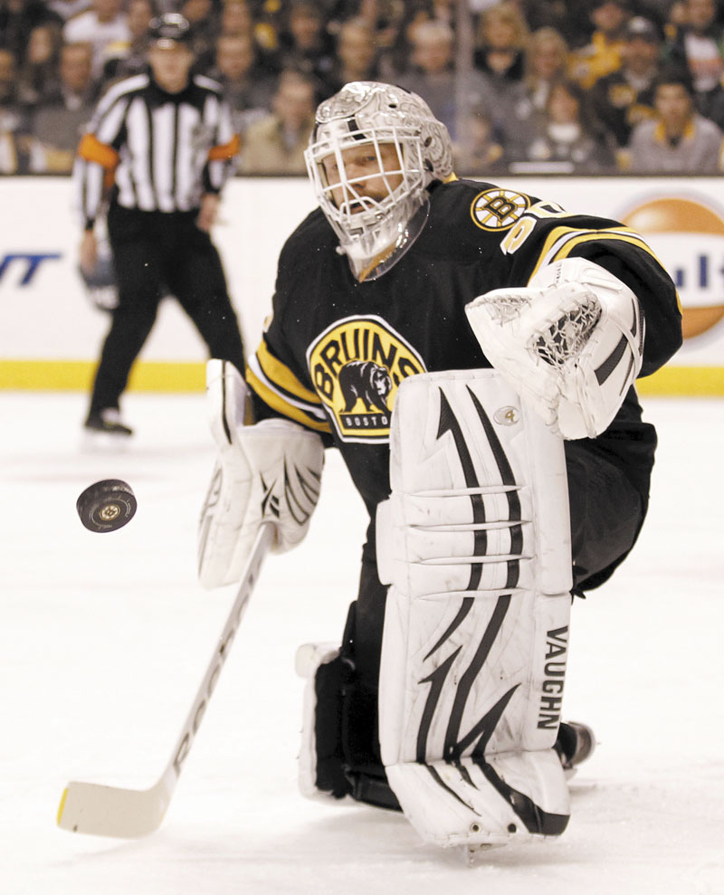 SHOT, SAVE: Boston Bruins goalie Tim Thomas makes a save against the Montreal Canadiens during the first period Monday in Boston.