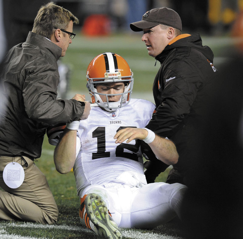 AP photo SCARY THOUGHTS: Cleveland Browns quarterback Colt McCoy is helped off the field after suffering a concussion earlier this season. In a series of interviews with The Associated Press, 23 of 44 NFL players said they would try to hide a brain injury rather than leave a game.