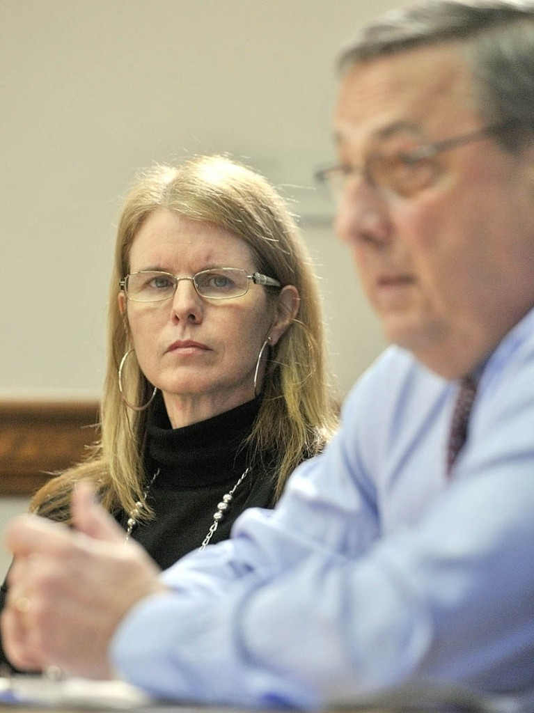 Department of Health and Human Services commissioner Mary Mayhew, left, listens to Gov. Paul LePage during a news conference on Thursday in the State House in Augusta.