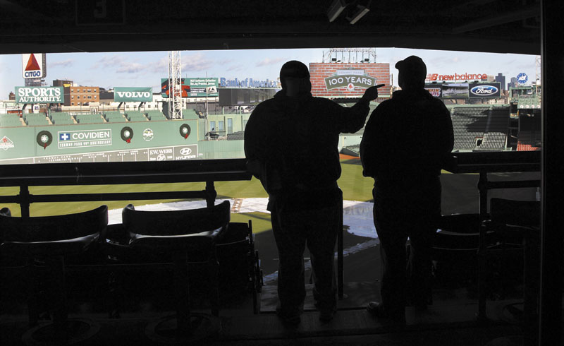 NICE DAY AT THE PARK: Two fans look out over the field at Fenway Park in Boston on Thursday at a news conference announcing upcoming events to celebrate the 100th anniversary of Fenway Park, the oldest operating Major League Baseball park in the United States.