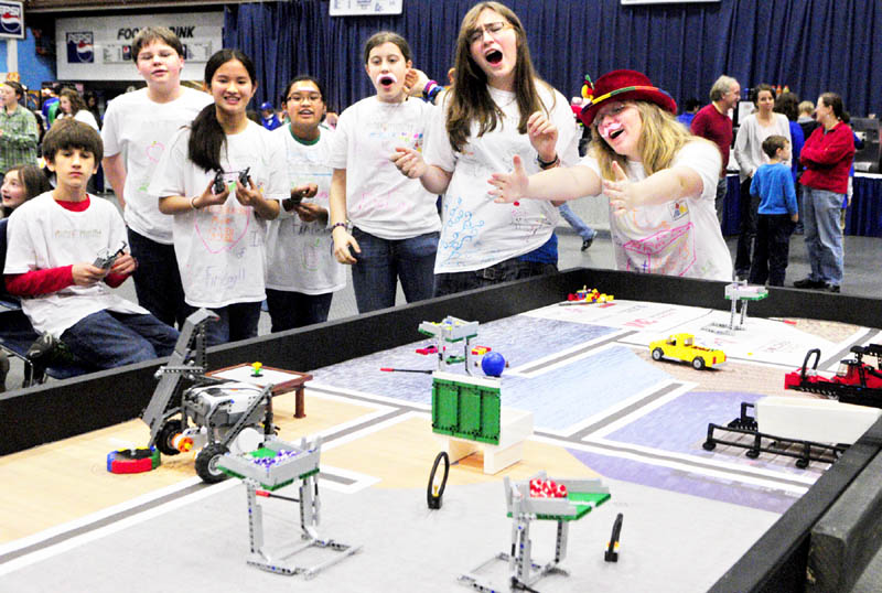 IT'S ROBOTIC: Messalonskee Middle School students Katelyn Naslund, far right, and Sarah Cormier, second from right, and the rest of the Infinite Fruit Loops react as their team's robot misses a task during the Maine First LEGO League Championship on Saturday at the Augusta Civic Center. About 500 students on 62 teams from across the state competed in the robotics contest.