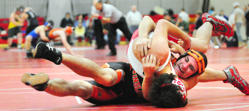 TAKEDOWN: Winslow's Bryan Robbins, back, wrestles with Cony's Cody Geroux in a 152-pound match during the Cony Duals on Tuesday at Cony High School in Augusta.
