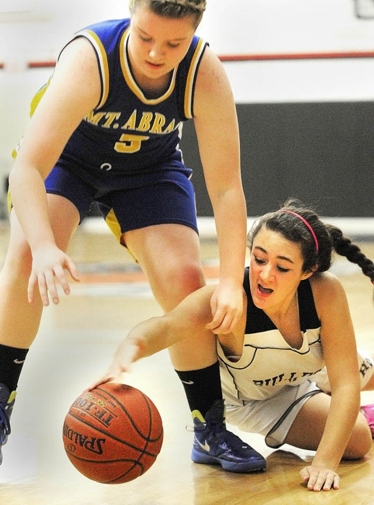 SCRAPPY PLAY: Mt. Abram's Tori Lyn Beane, left, and Hall-Dale's Wendy Goldman battle for a loose ball during a game Thursday night at Hall-Dale High School's Penny Memorial Gymnasium in Farmingdale.