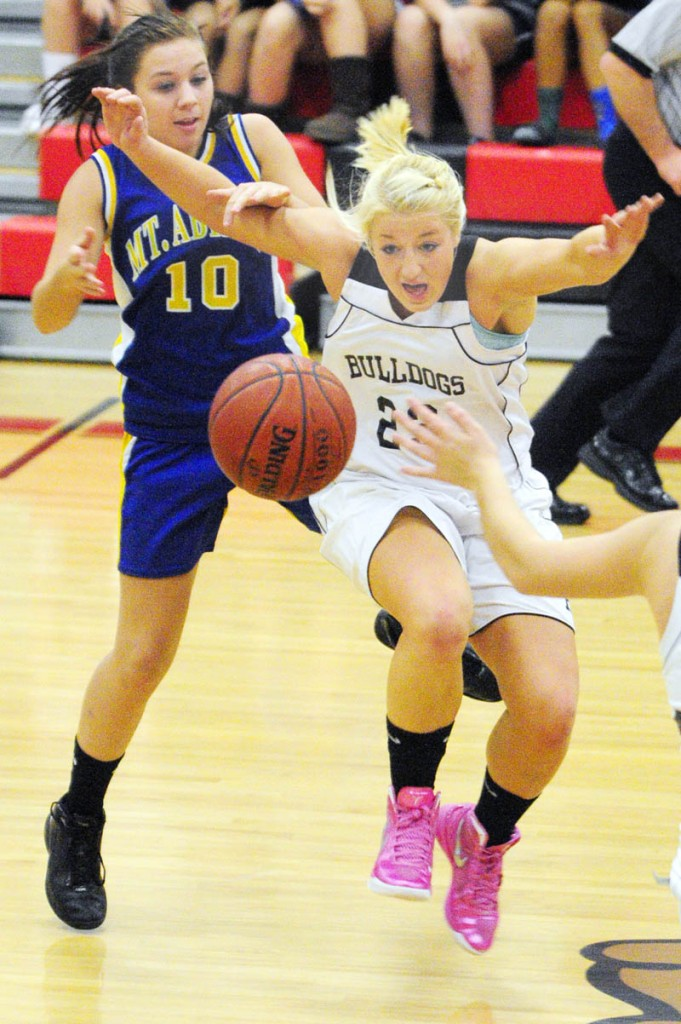 BATTLE FOR POSSESSION: Mt. Abram's Samantha Werzansk, left, and Hall-Dale's Carylanne Wolfington battle for a loose ball during a game Thursday night at Hall-Dale High School's Penny Memorial Gymnasium in Farmingdale.