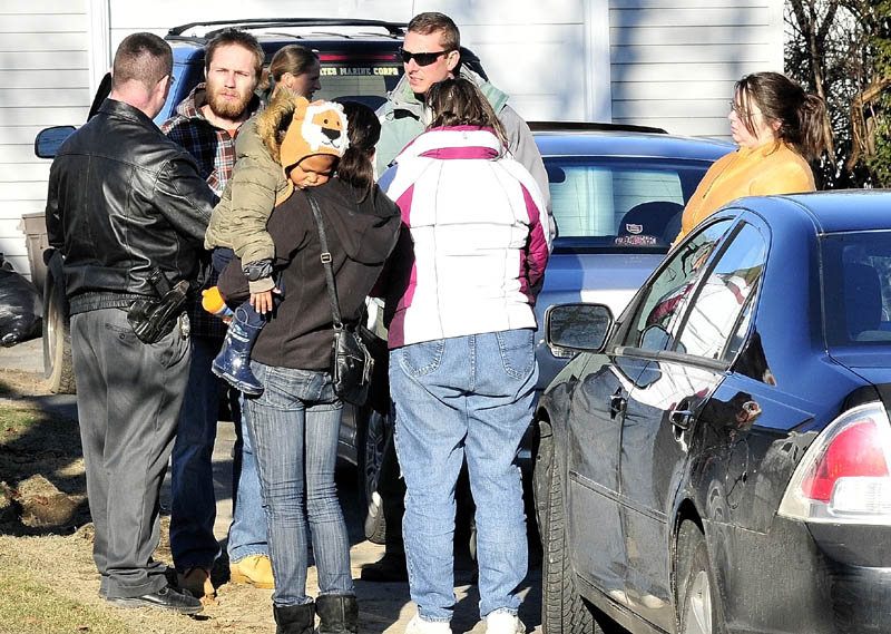 DESPAIR: Maine State Police Detective Christopher Tupper, left, and Waterville Detective Lincoln Ryder, at right, question Justin DiPietro after he arrived at his home on Violette Ave. in Waterville on Sunday as an extensive search was underway at his home and the neighborhood for his 20- month- old daughter Ayla Reynolds who has been missing since Friday.